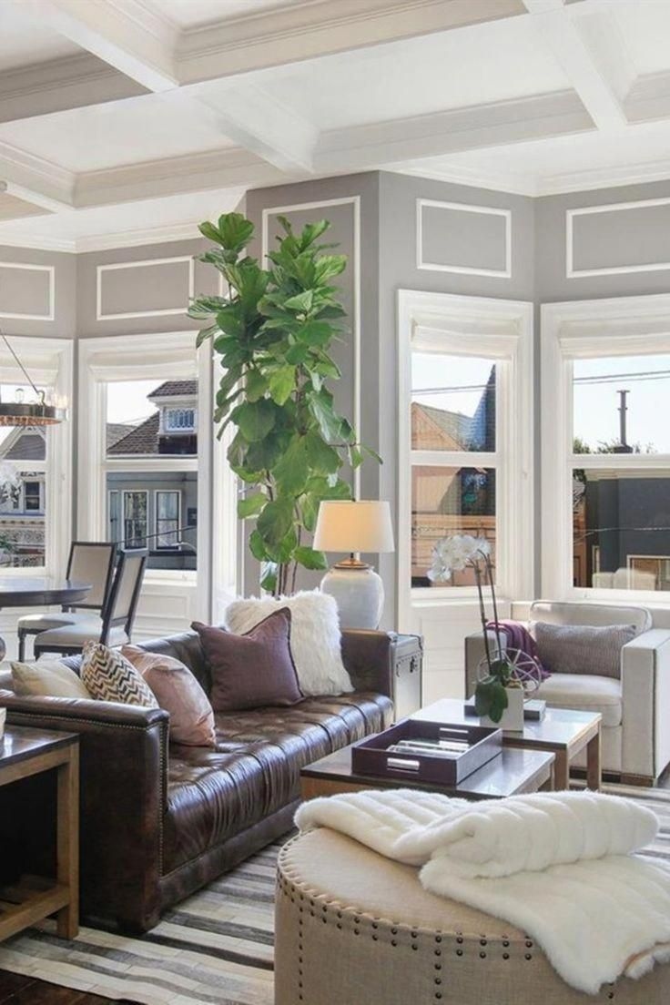 Classic small living room with brown leather sofa and ...