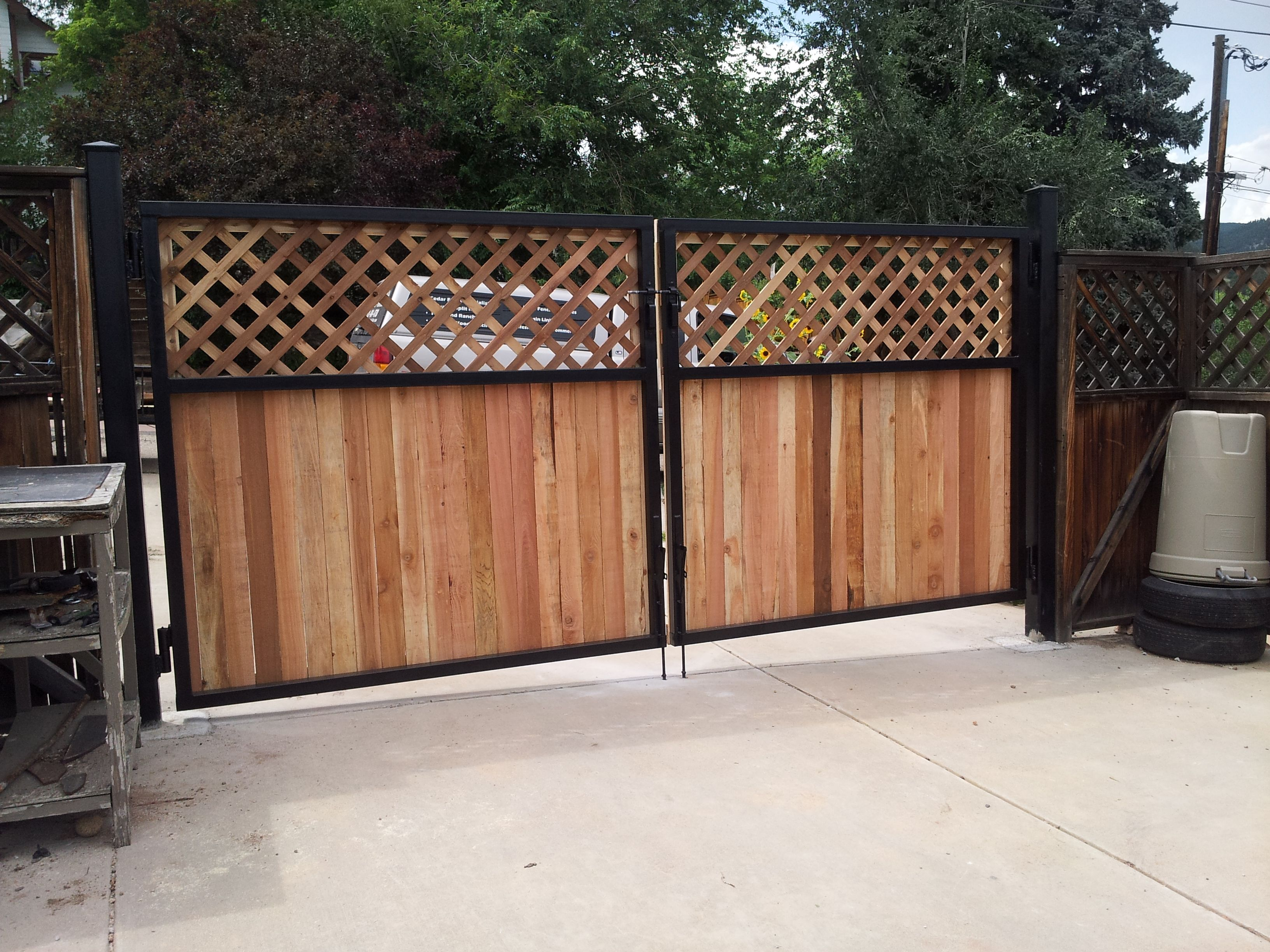 Iron Gate With Cedar No Lattice But Vertical Iron Slats On Top Cedar Steel Lattice Top Double Drive Gates Boulder Wrought Iron Fences Iron Fence Drive Gates