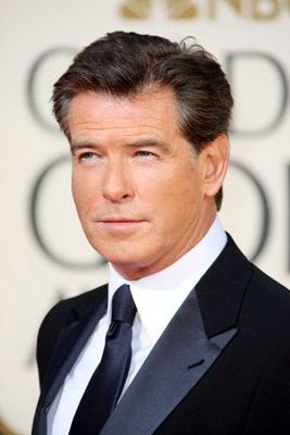 Pierce Brosnan (born 1953) exudes class and style, but what else would you expect from a former James Bond? wearing classic suits, Pierce looks dashing at every event he attends. And here is further proof that a crisp white shirt and black tie is always a smart choice at important events.