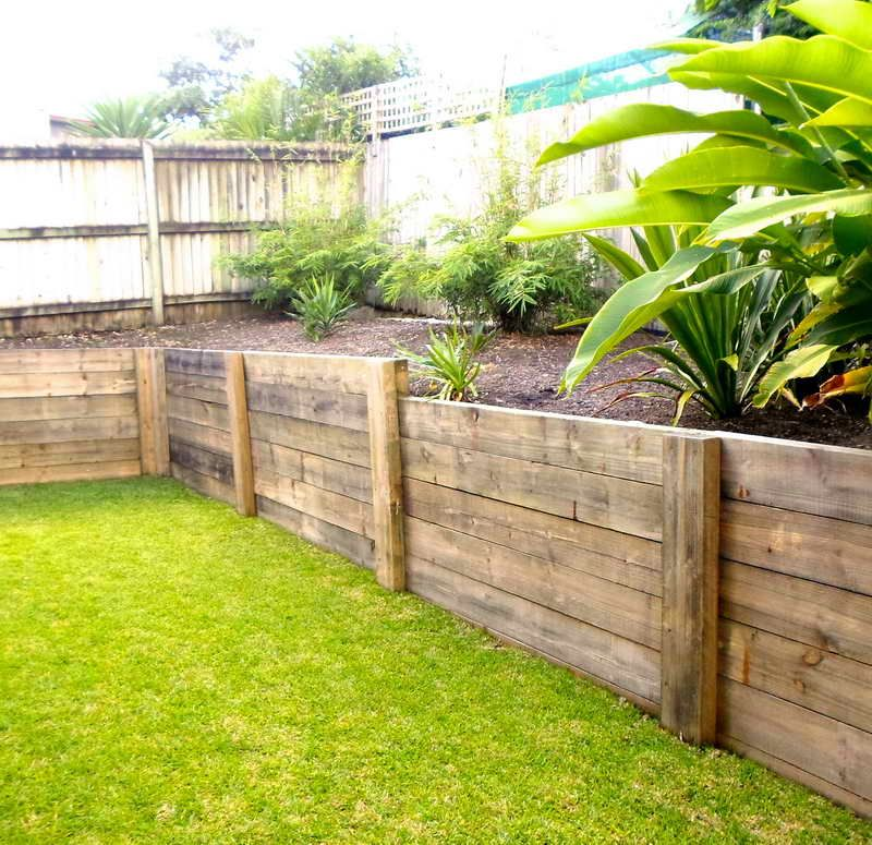 wood retaining wall with ornamental plants container gardening wood retaining wall garden. Black Bedroom Furniture Sets. Home Design Ideas