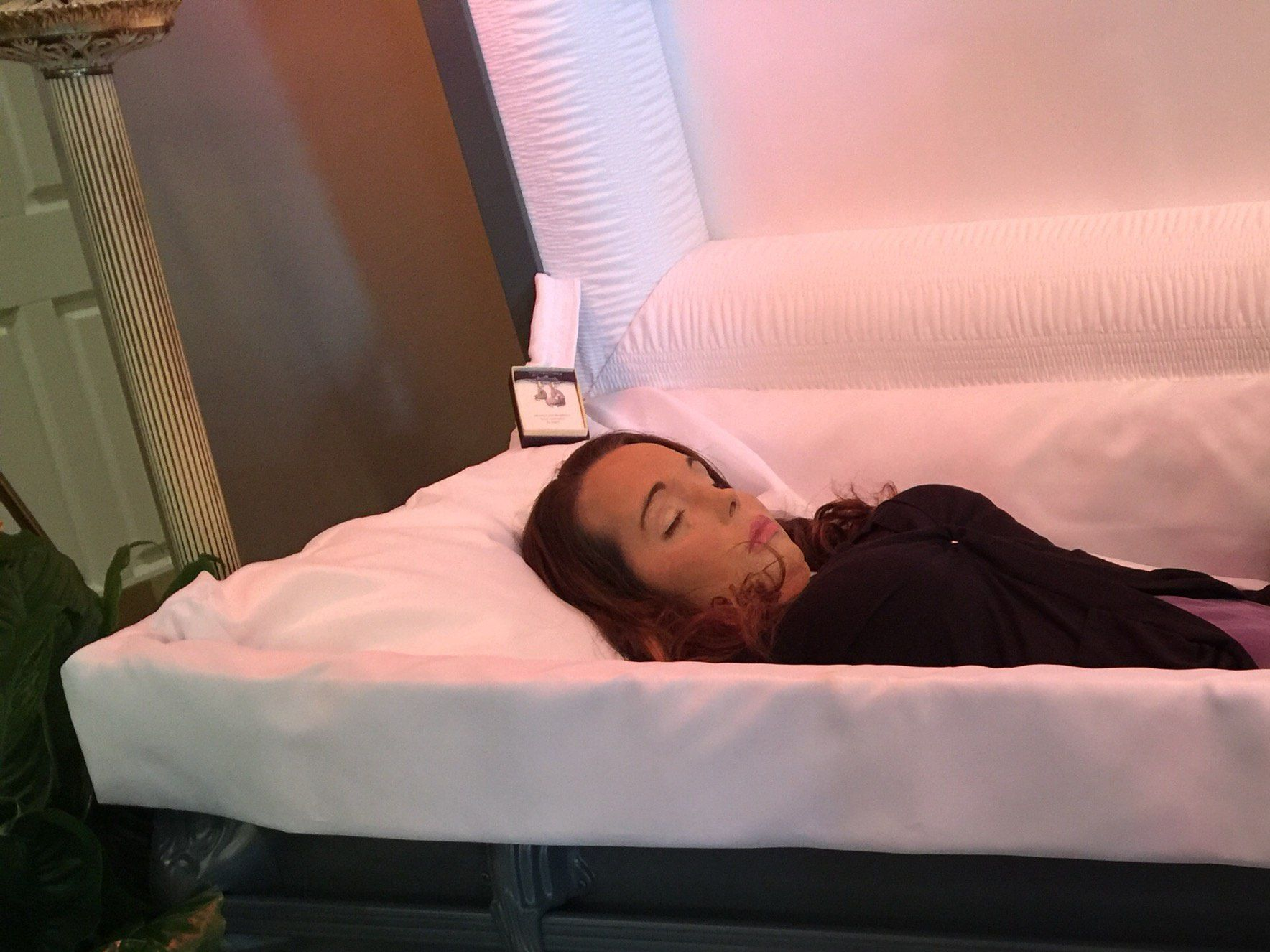 Necrobabes Postmortem: An American Woman In Her Open Casket During Her Funeral