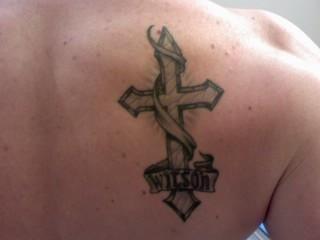 Cross Tattoo On Shoulder Blade