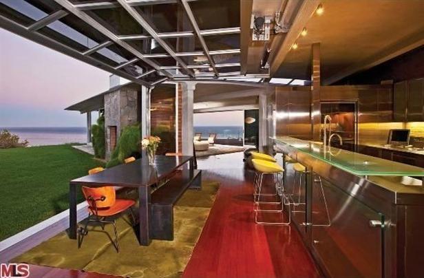 glass garage door in kitchen.  Glass Brad Pittu0027s Kitchen With A Glass Garage Style Door Opening Onto The Ocean With Glass Garage Door In Kitchen E
