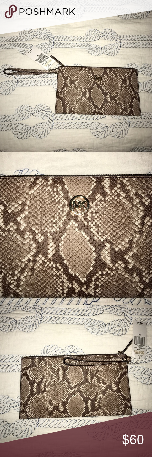 Michael Kors Snake Print Leather Wristlet Adorable snake print leather wristlet from Michael Kors! Perfect for a day or night one with plenty of room for a phone and other items, as well as spaces for cards on the inside! NWT. Michael Kors Bags Clutches & Wristlets