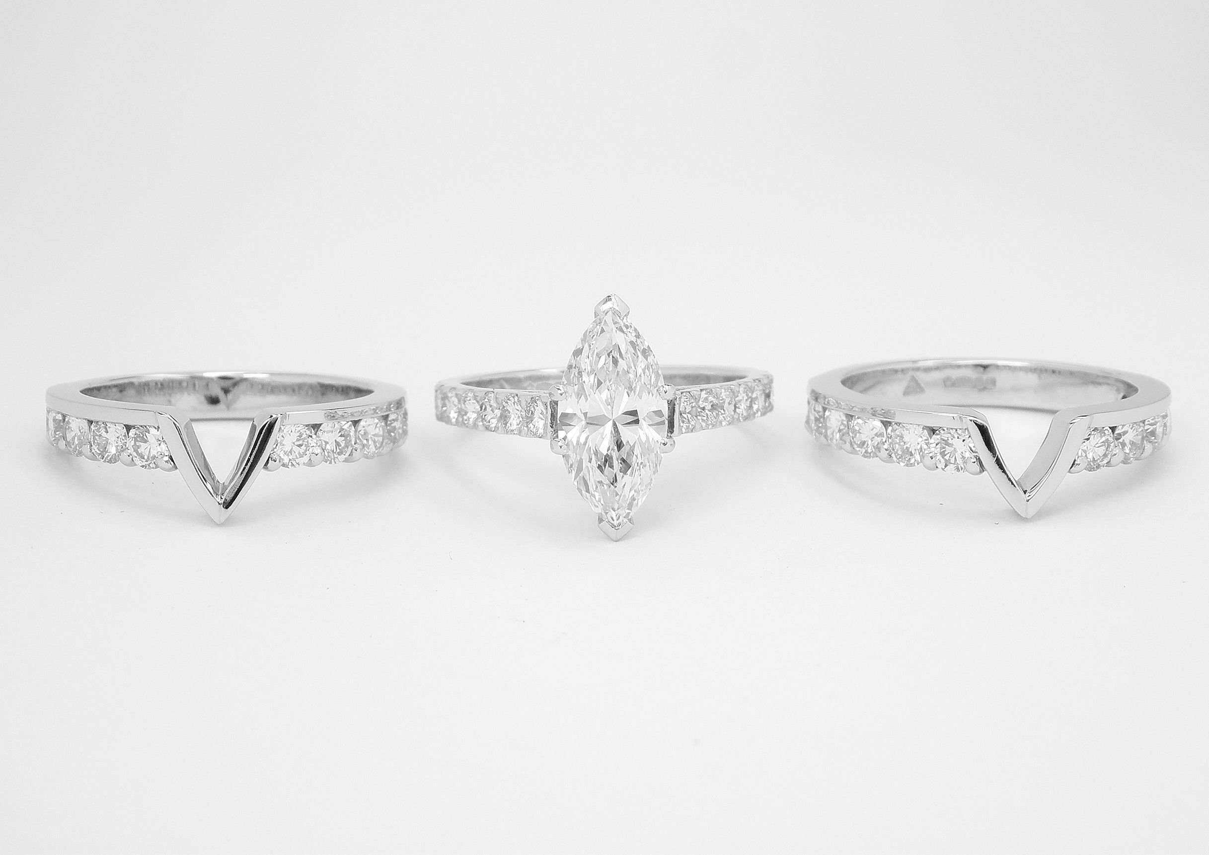 A Pair Of Twin Platinum Part Channel Set Diamond Wedding Rings