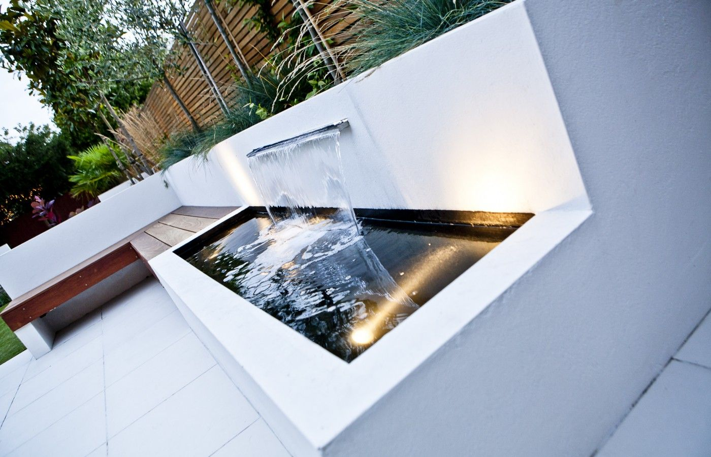 Modern water feature in the white patio section of the for Modern pond ideas