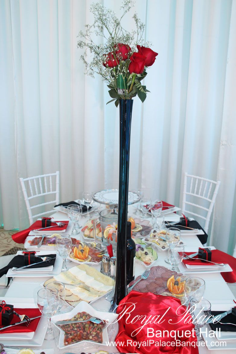 Red and black wedding decor  Black vase with red roses wedding centerpiece at Royal Palace