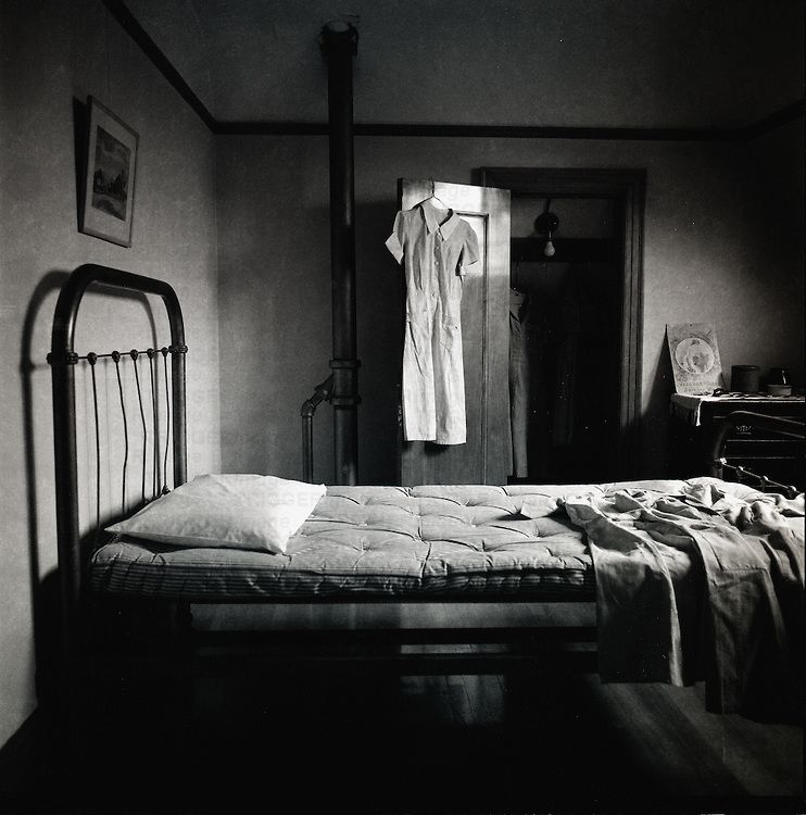 An Old Fashioned Bedroom With Mattress On Bed And Open