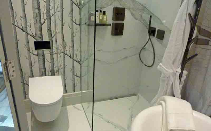 luxury walkin shower by harrods featuring porcelthin calacatta book matched marble effect thin porcelain wall tiles