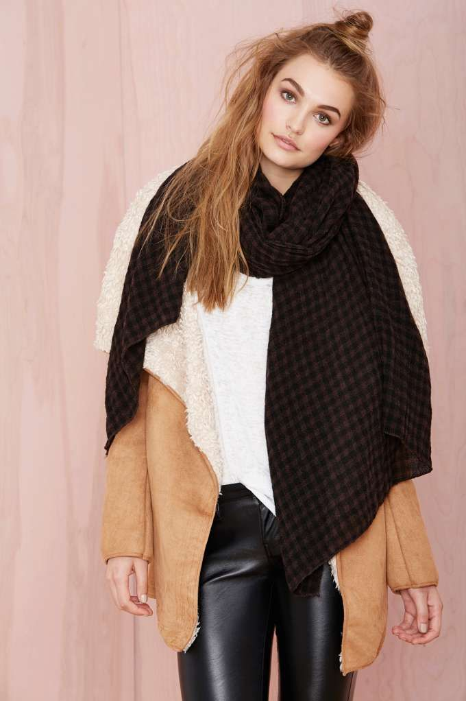 This cozy black scarf has a checkered print and the softest fabric.