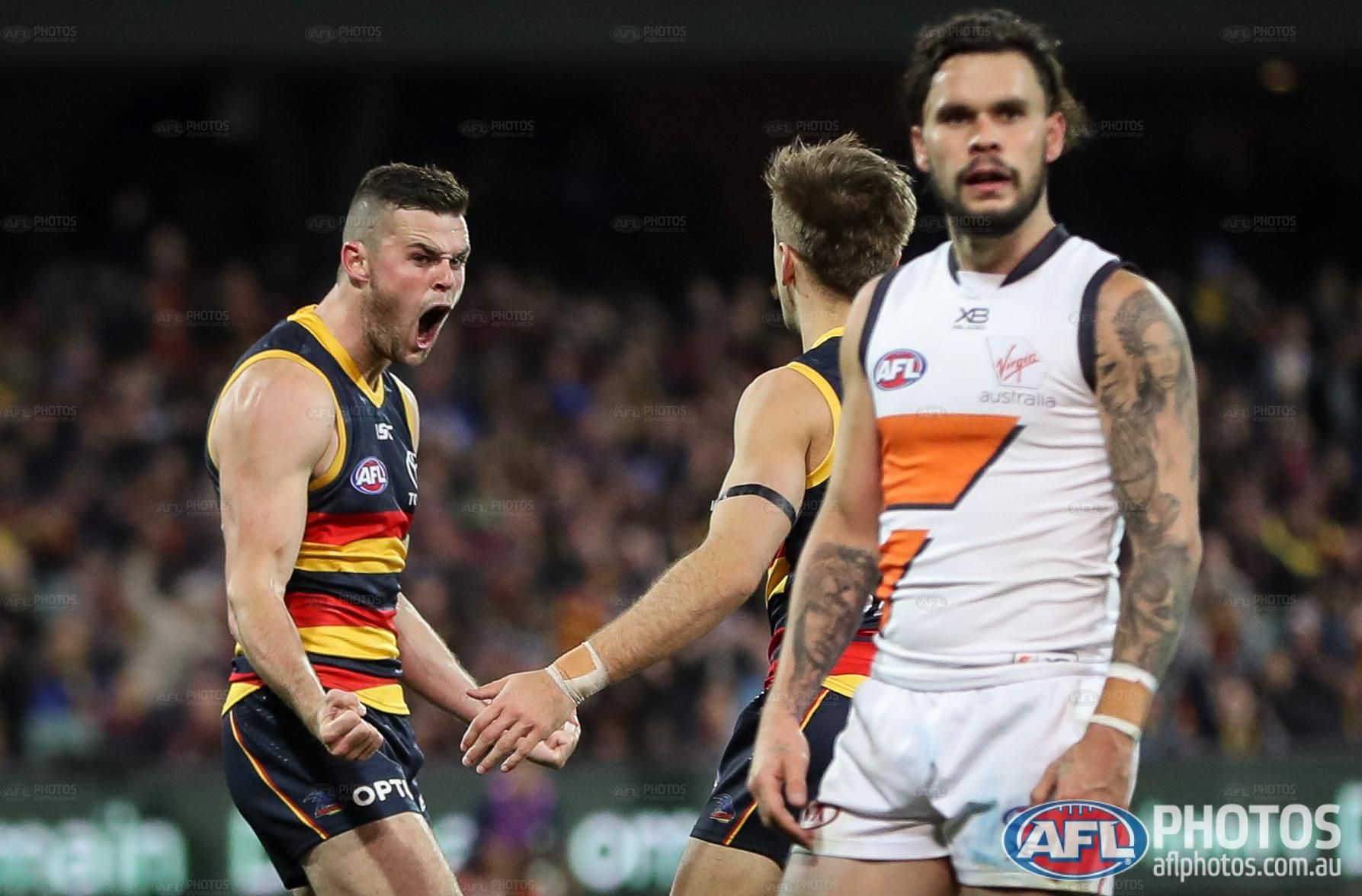 Aussie Rules suspends season for at least two months over