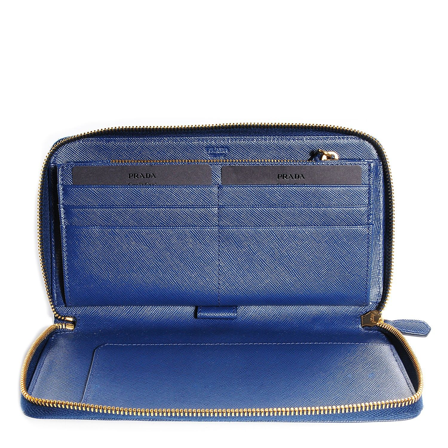 1d6f51133e2789 This is an authentic PRADA Saffiano Metal Zip Around Organizer Wallet in  Bluette. This is