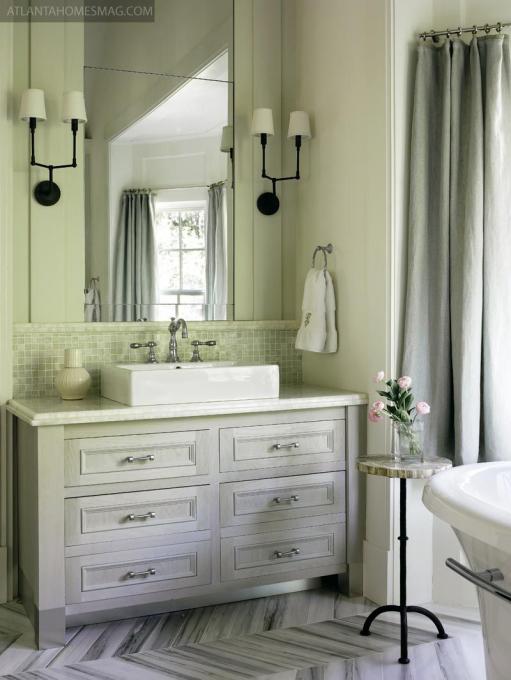 Photo of Atlanta Homes & Lifestyles  Warm grey bath with herringbone floor #bathroomfixtu…