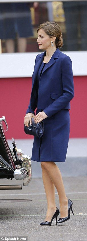 Queen Letizia was poised in a smart but stylish navy suit.