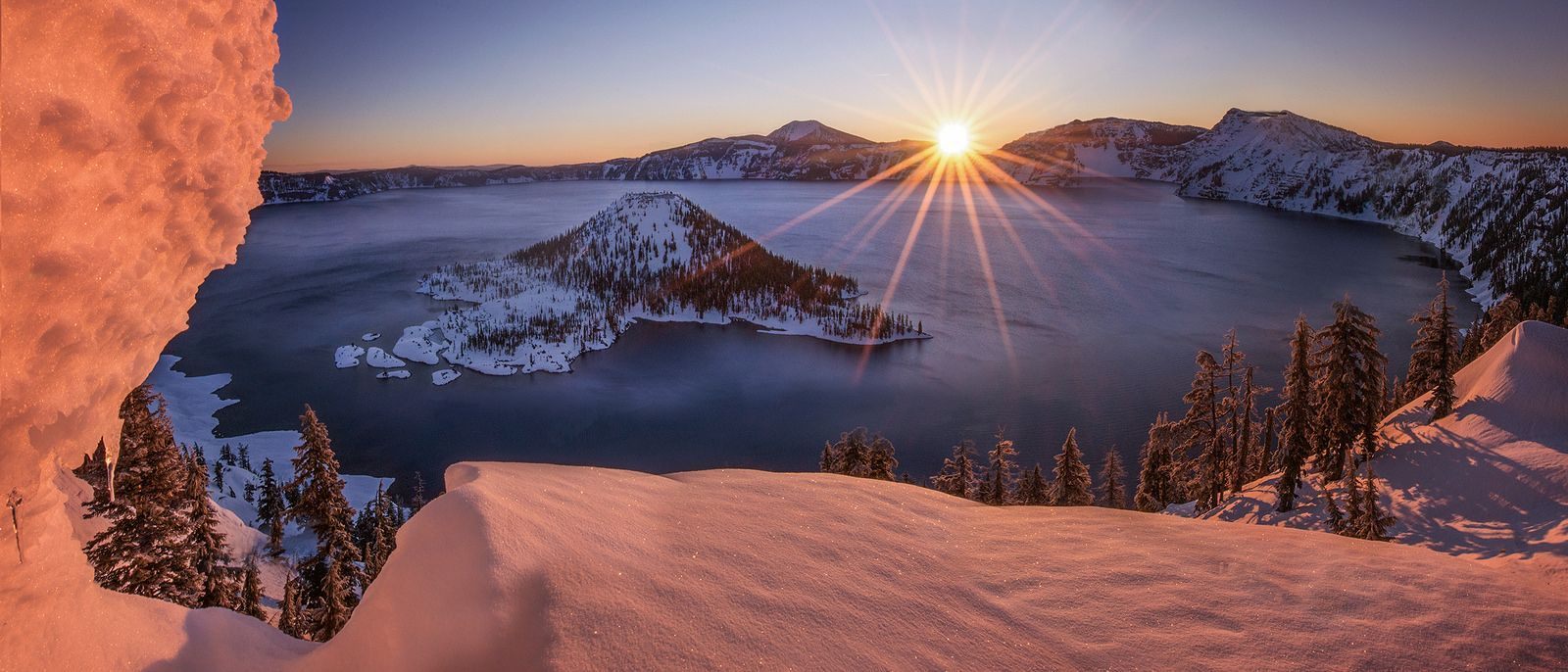 Warmth of Winter (Explored) #craterlakeoregon Crater Lake, Oregon Please Connect with me: Facebook * 500px * Instagram www.sapnareddy.com Inspired by the work of Alex Noriega. Have wanted to shoot Crater Lake in winter for a while now. Having never snowshowed before I was both intimidated and intrigued by the 5 mile hike that is involved in getting this shot. The trail is along the rim road which gets shut down in winter. I used the women's version of the red feather snowshoes and they worked be #craterlakeoregon