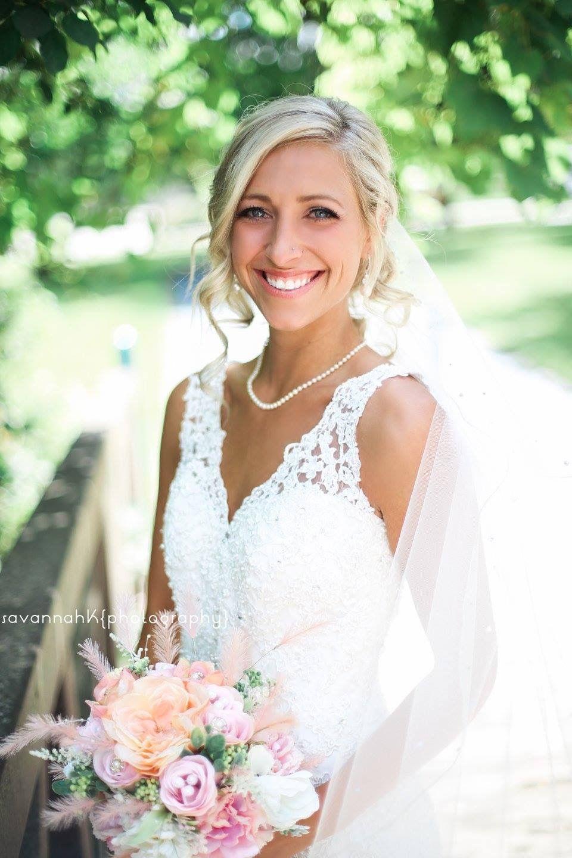 Diy flowers pearls lace wedding dress veil natural lighting