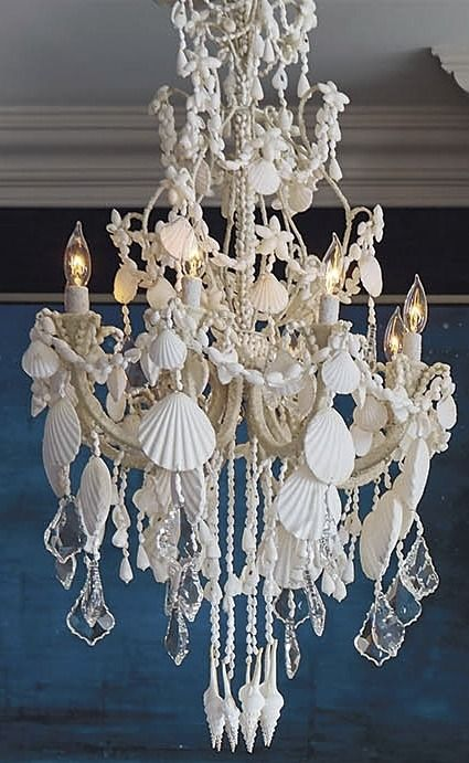 An ethereal symphony of cascading crystals and seashells our harbor an ethereal symphony of cascading crystals and seashells our harbor shell chandelier casts a captivating aloadofball Image collections