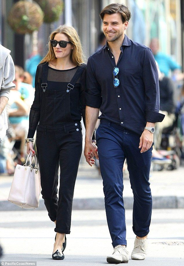 5079f806a84c4f Complementary couple: Olivia was stylish as ever in black denim overalls  and a long-sleeved top featuring sheer sleeves and neckline, paired.
