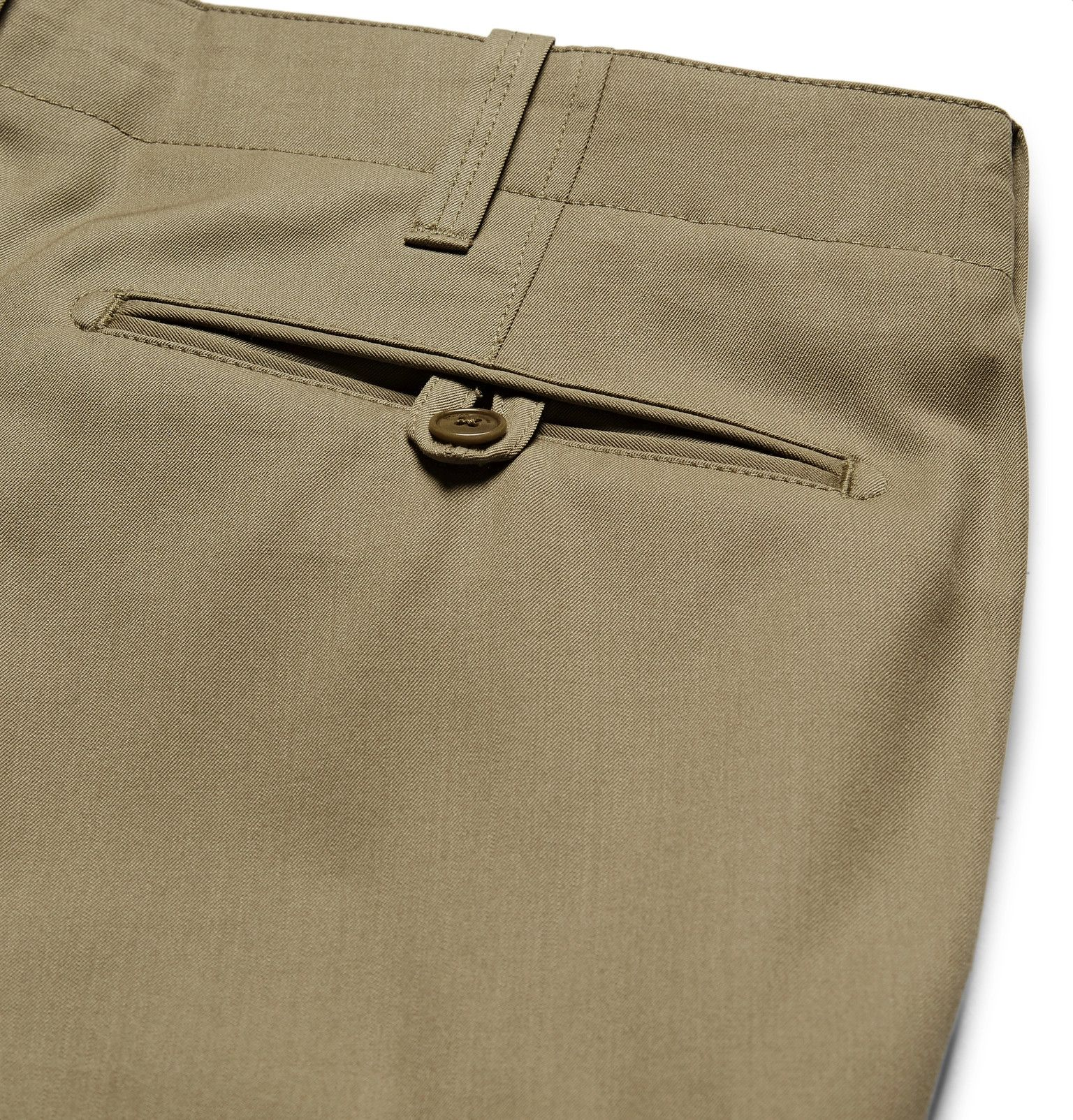 <a href='http://www.mrporter.com/mens/Designers/Ralph_Lauren_Purple_Label'>Ralph Lauren Purple Label</a>'s 'Cargo Flight' trousers are modelled after an Air Force suit. They have been expertly crafted from olive wool-gabardine and designed with utilitarian-inspired details. Team them with a pared-back suede jacket and high-top sneakers.