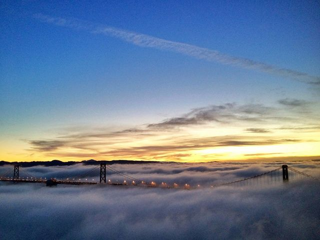 San Francisco Bay Bridge in the clouds at sunrise
