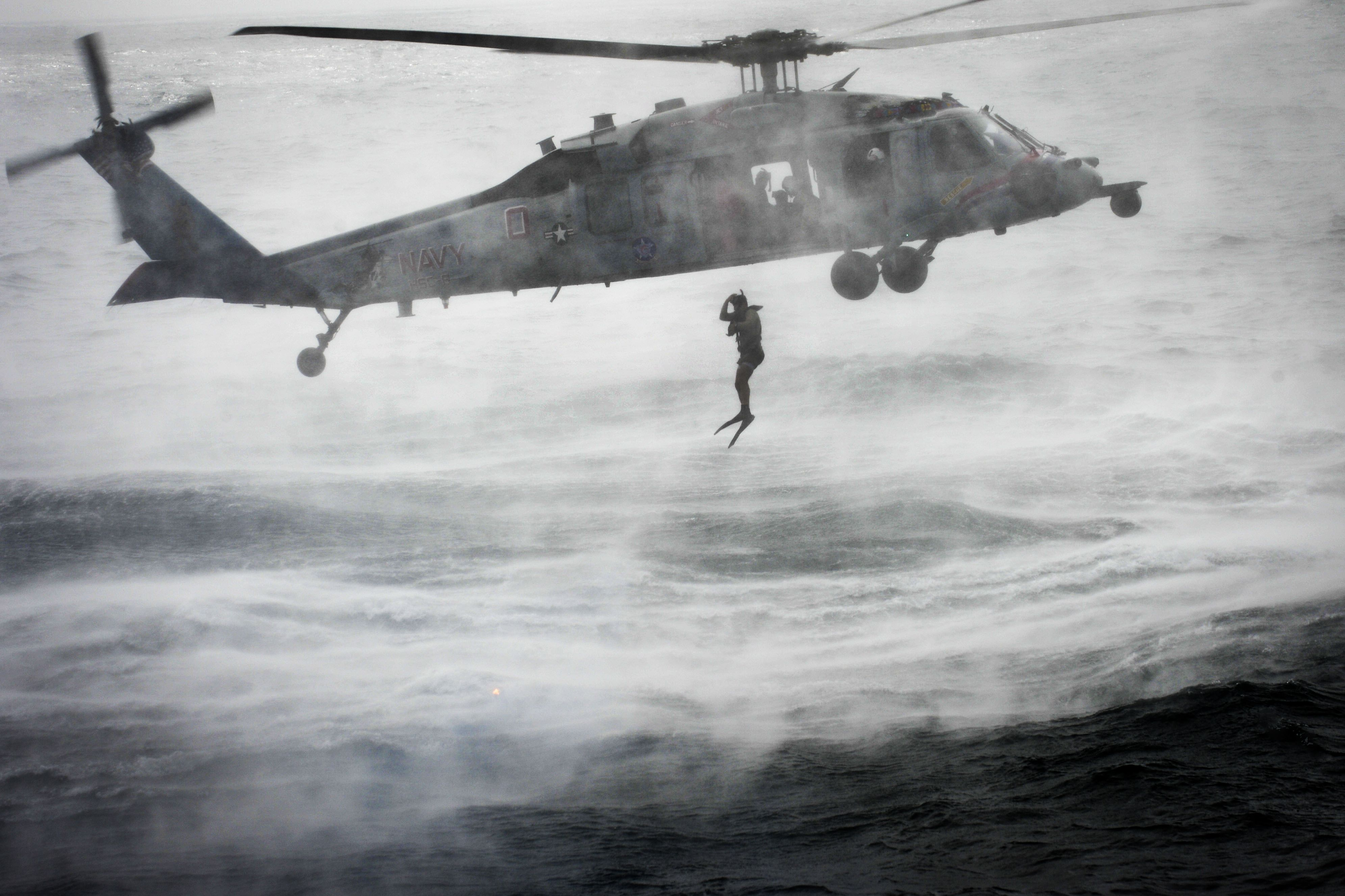 SEA SEARCH TRAINING - A U.S. Navy search and rescue swimmer jumps ... for Great White Shark Jumping At A Helicopter During Training  111ane