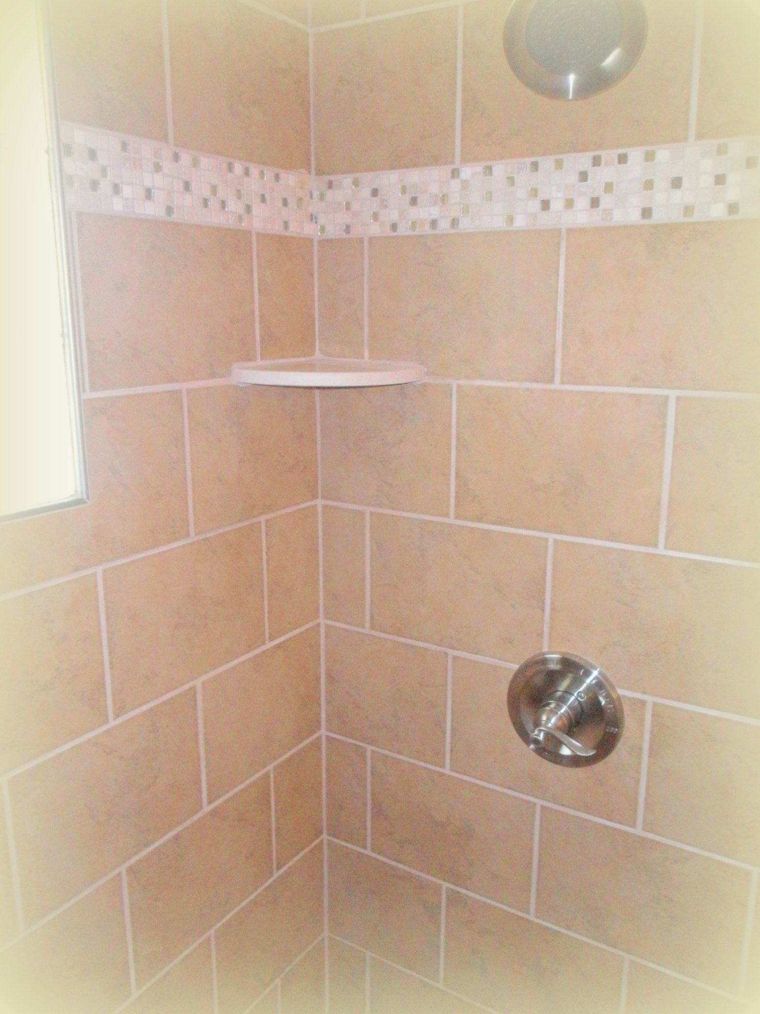 tiled shower with marble corner shelf, tileshaw, and