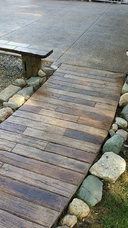 Stamped stained wood plank concrete this looks amazing - Stamped concrete walkway ideas ...