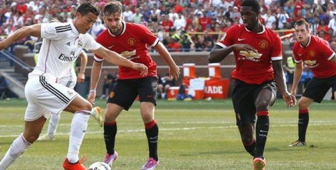 Manchester United defeat Real Madrid 3-1 in front of record crowd