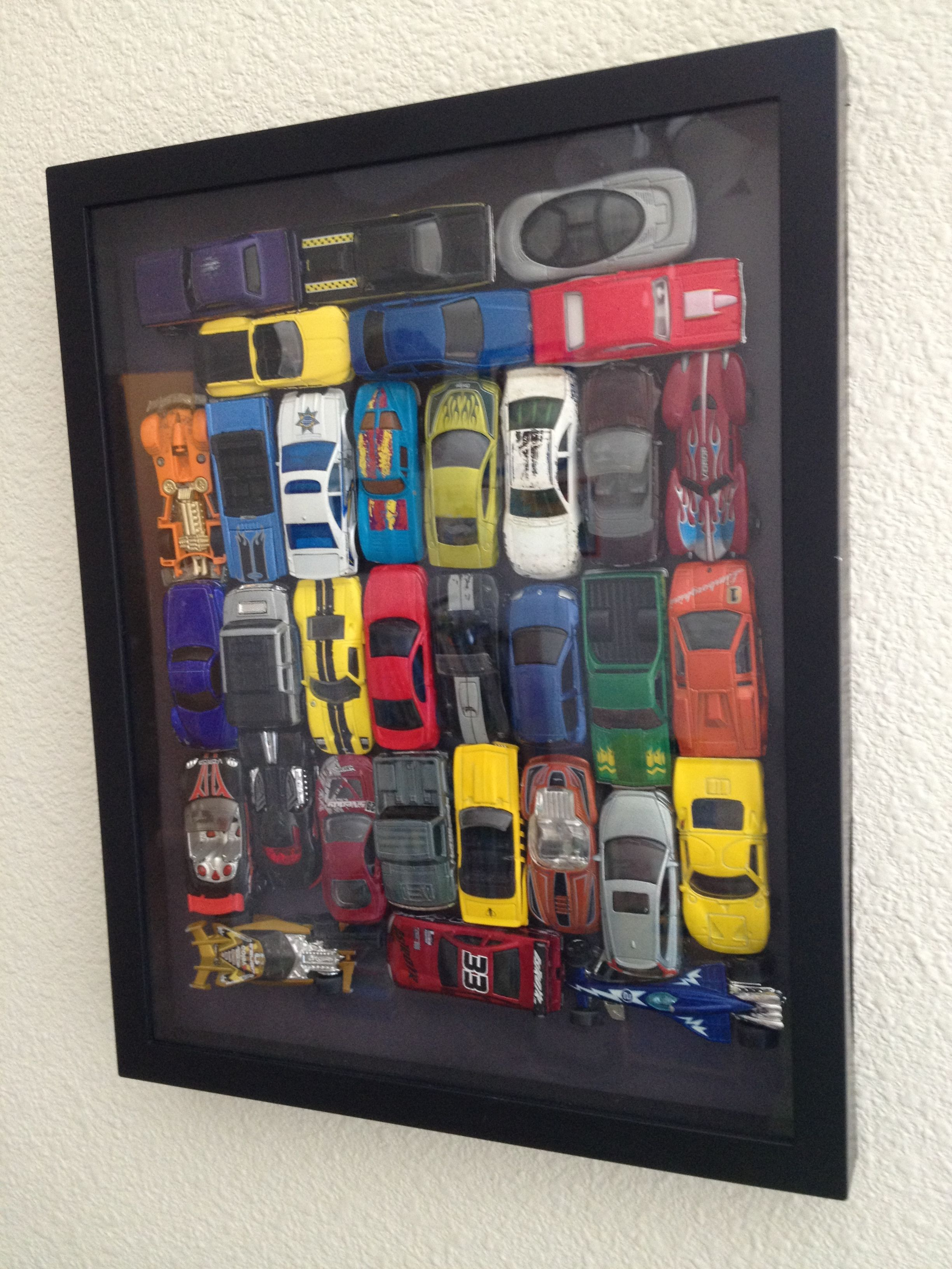 Matchbox/hotwheels cars shadow box. These are some of my sons hand ...