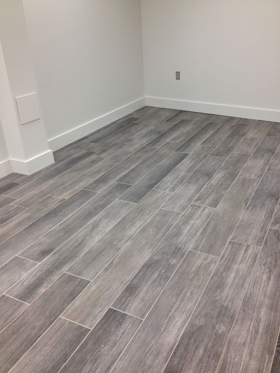 Gray wood tile floor no3lcd6n8 homes pinterest wood tile our porcelain tile lux wood installed on this room floor dailygadgetfo Image collections