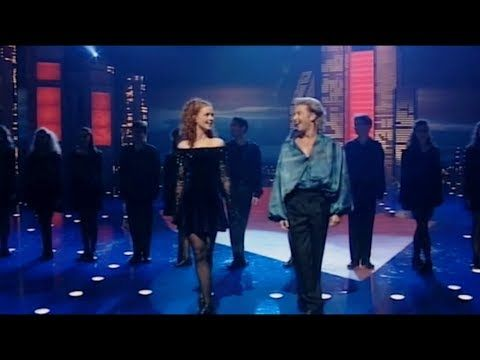 The opening number of Riverdance, Reel Around The Sun,with Breandán de Gallaí as the lead dancer. From the show in Geneva, 2002.