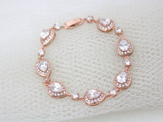 This lovely bracelet I created using amazing clear Swarovski Pure Brilliance stones set in rose gold, 18K gold or rhodium plated components. Super sparkly teardrop components are surrounded by tiny cz stones. Teardrops measure 10mm x 12mm. Bracelet size can be chosen from the drop down menu. Bracelet is 3/8 at its widest point.  This is an original design by © Treasures by Agnes  READY TO SHIP  MATCHING NECKLACE…