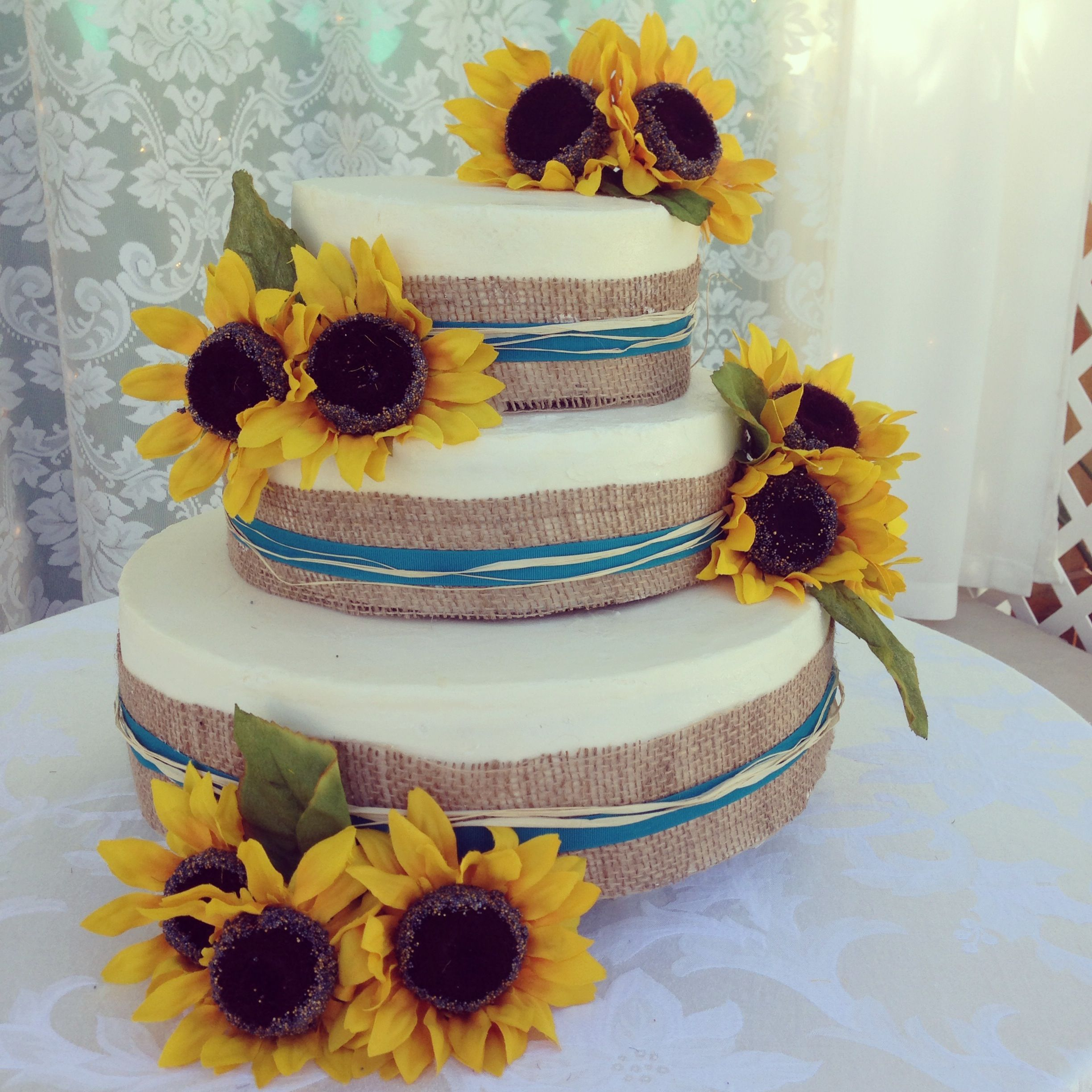 Simple sunflower 3 tier wedding cake wrapped in burlap