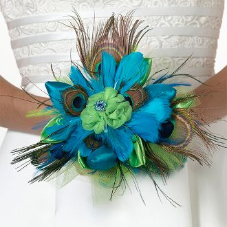 "Peacock Feather Bouquet - This exquisite 9"" bouquet combines peacock feathers with aqua feathers, green satin and green tulle. The middle flower is decorated with a rhinestone ornament. A 4"" long clear acrylic handle allows for easy carrying."