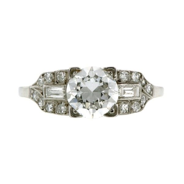 Vintage Engagement Ring, RBC 1.25ct::centering a Round Brilliant cut diamond weighing app. 1.25ct. (G color, VVS2 clarity), in a square mount flanked by two Baguette cut diamonds and fourteen Single cut diamonds, all weighing app. 0.38ctw., fashioned in platinum. Circa 1940. GIA 2155807683  Size 7.25