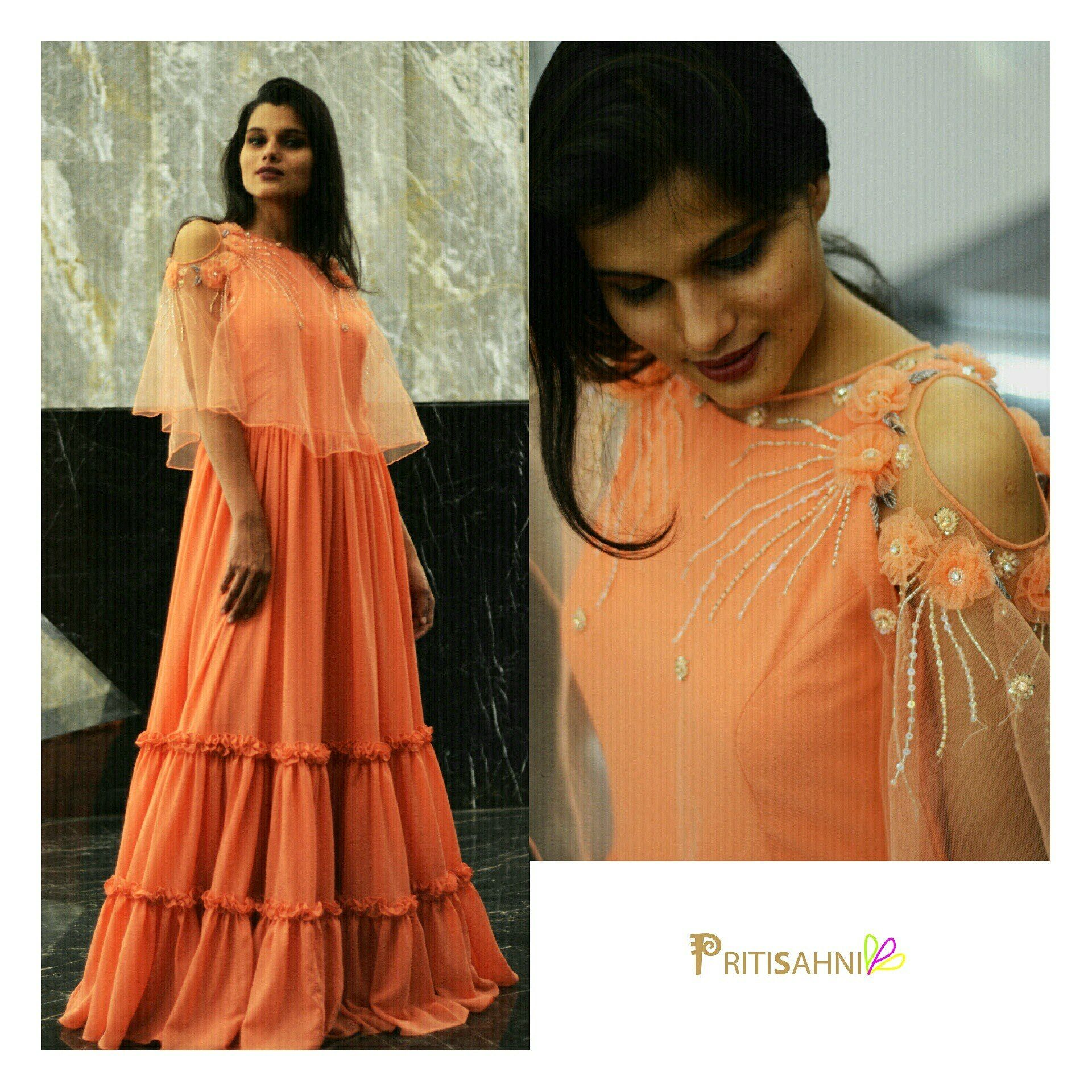 abff134e60 Tiers and Ruffles.Peach georgette gown with tiers and ruffle details ...