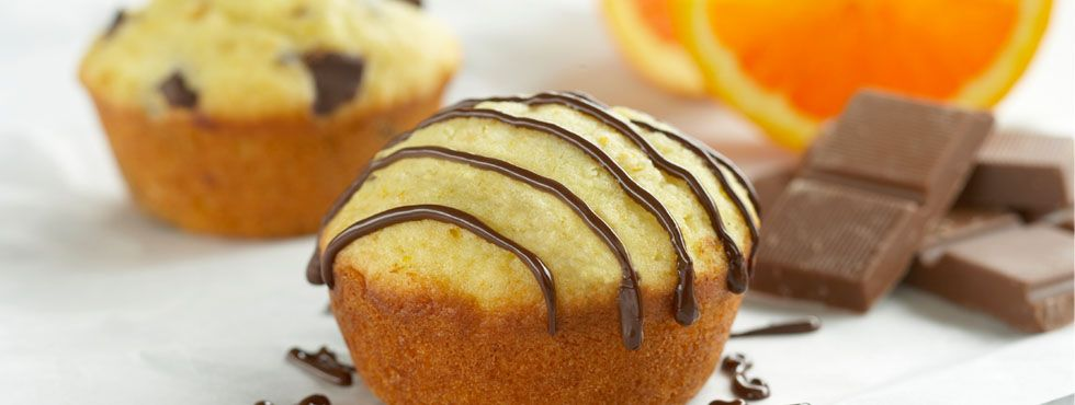 Chunky Chocolate and Orange Muffins | Tender and tangy, these muffins combine sweet chocolate and zesty orange to make a breakfast that'll really have you up and at 'em.