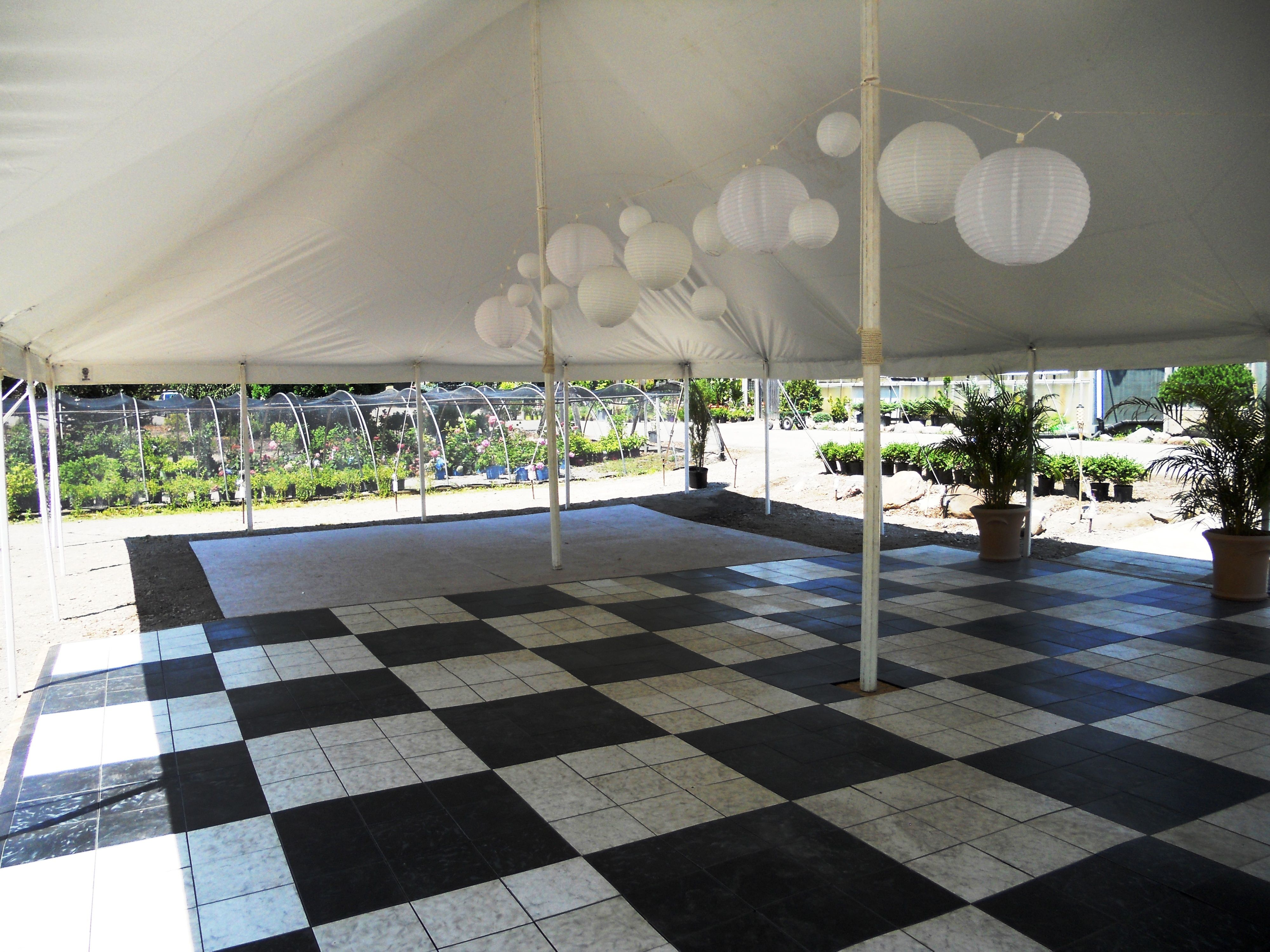 A wedding is a party without some dancing! Here's our 30 x 45 pole tent with our black and white dance floor, decorated with some of our Chinese lanterns. 844-TENT PRO