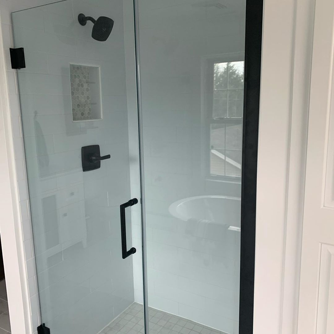 A Simple Stunning Frameless Glass Shower Door The Dreamline Unidoor Shower Door With Satin Black In 2020 Glass Shower Doors Frameless Glass Shower Shower Doors