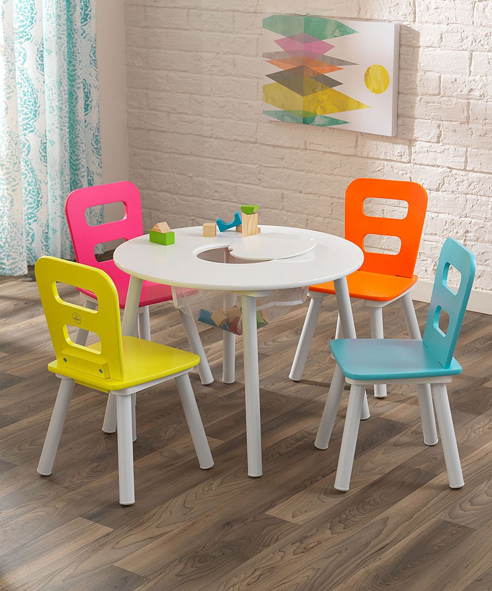 Engage in imaginative play, serve meals and play games with your little one at this bright set of table and chairs. Built in storage ensures activities are always within reach.Includes one table and four chairsTable: 23.5'' W x 17'' H x 23.5'' LChair: 11.5'' W x 20.5'' H x 12'' LMDFAssembly requiredRecommended for ages 4 to 6 yearsImported