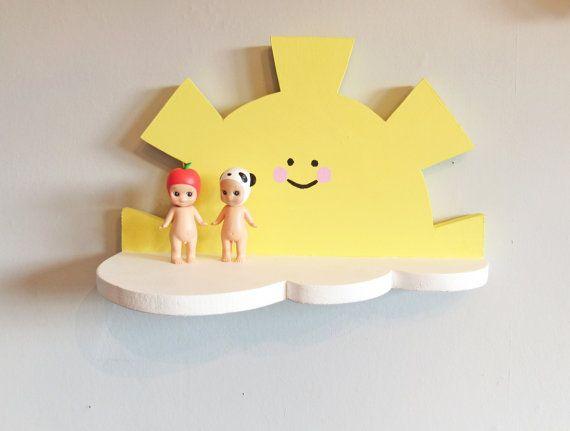 Beautiful handmade natural pine sun above a cloud shelf in yellow ...