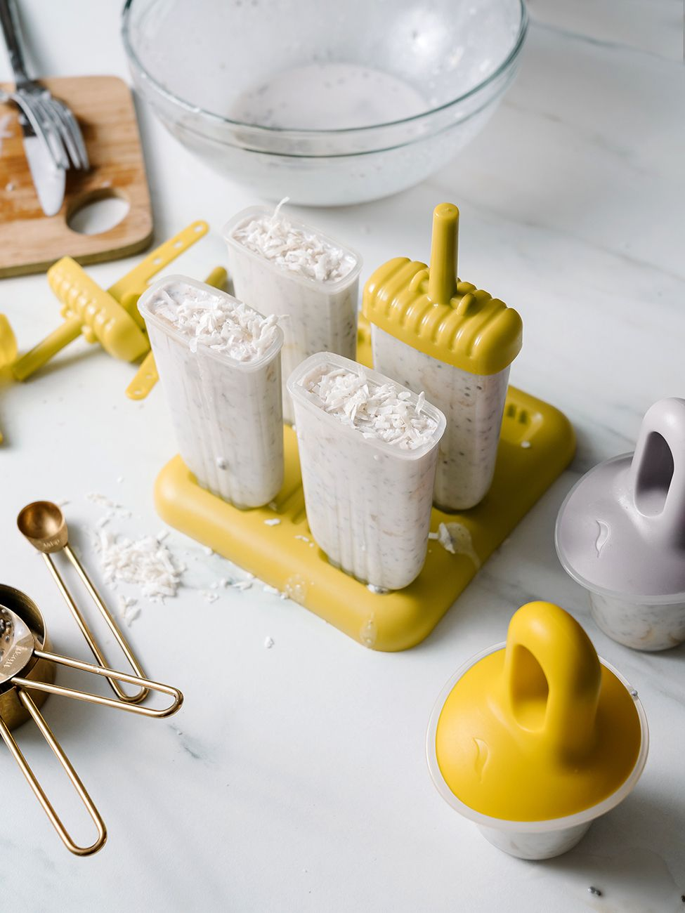 Coconut Banana Popsicles Looking for the perfect summer snack to fill you up and keep you cool? This super easy coconut banana popsicle recipe is a go-to in our house! There's no preservatives, additives, food dyes or sugar like most store bought popsicles - and did I mention they're only six ingredients that can be thrown together in less than 10 minutes?! Try it!