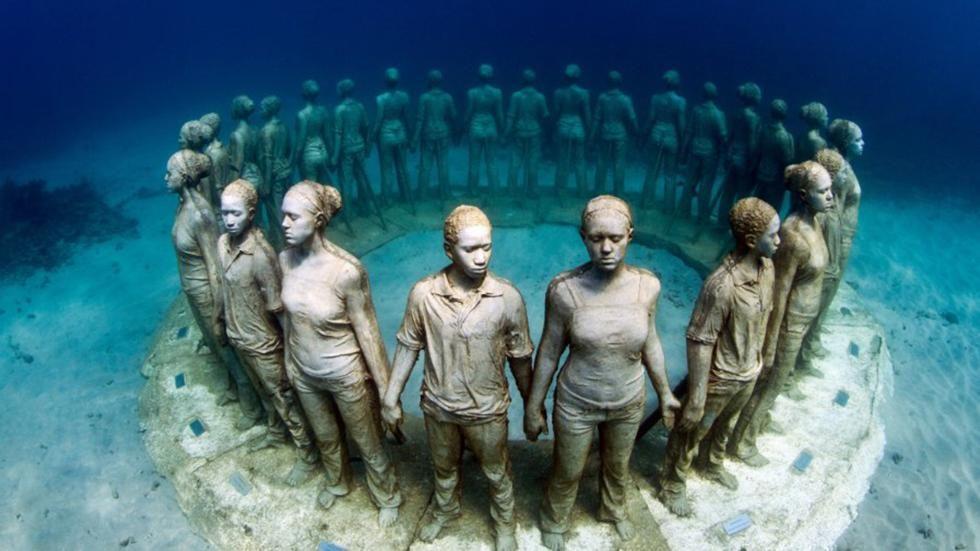 Stunning Underwater Sculptures Help Marine Life PHOTOS - Europes first ever underwater museum is full of hyperrealistic human sculptures
