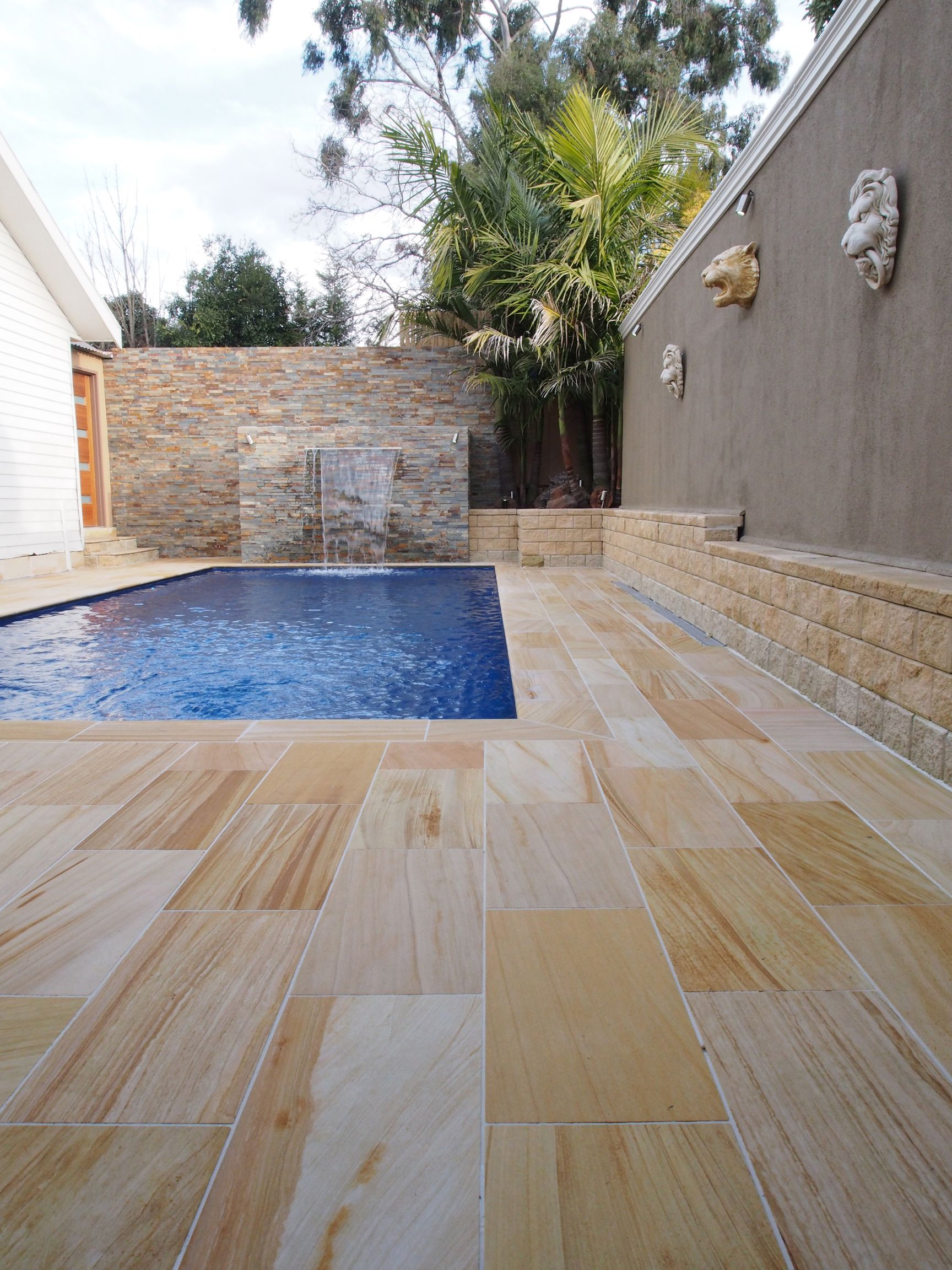 Teakwood Sandstone Tiles Around The Pool Sandstone