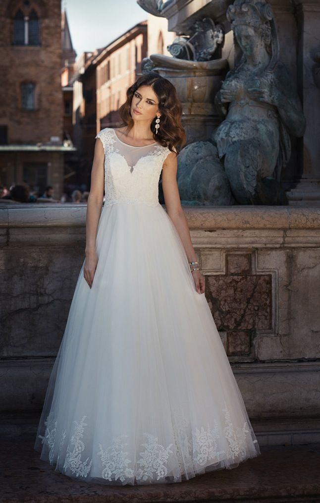 Tulle A Line Gown Decorated With Lace Applique On The Bodice And On