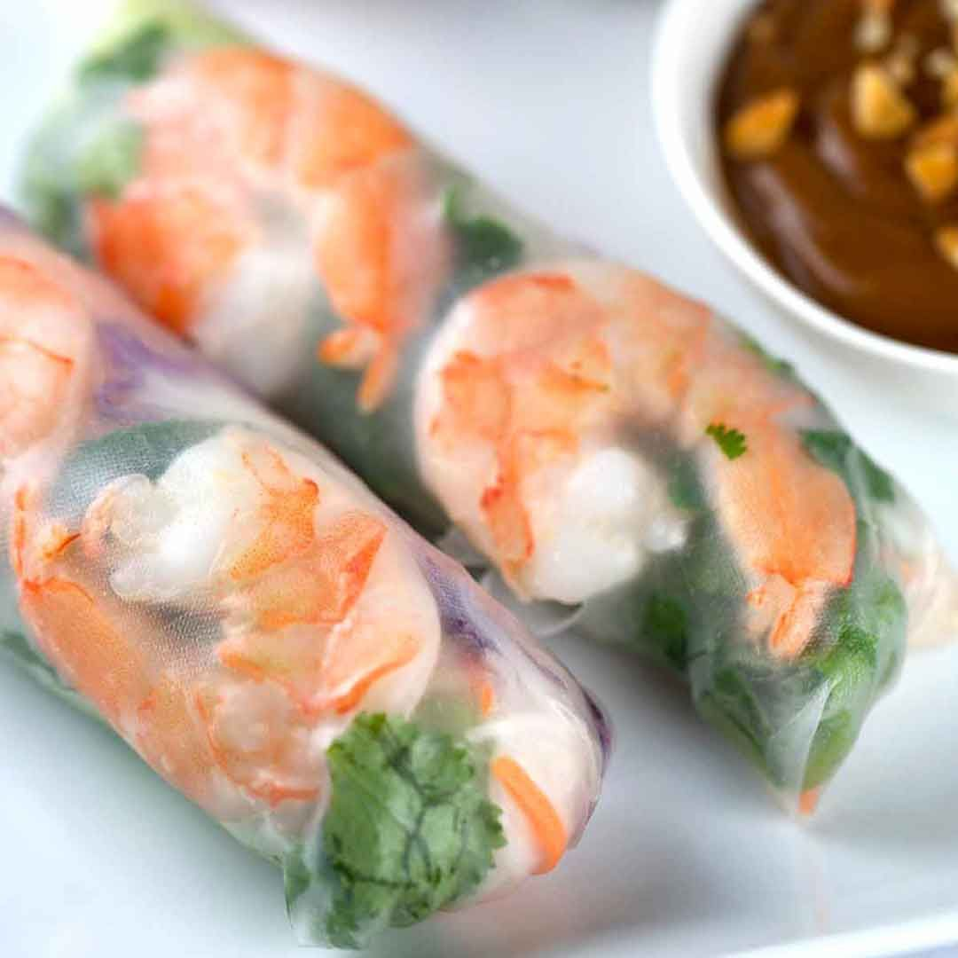 Fresh Shrimp Spring rolls with peanut dipping sauce is a refreshing and delicious appetizer. Each roll is filled with healthy crisp vegetables and herbs. #springrolls #vietnamasefood #appetizer