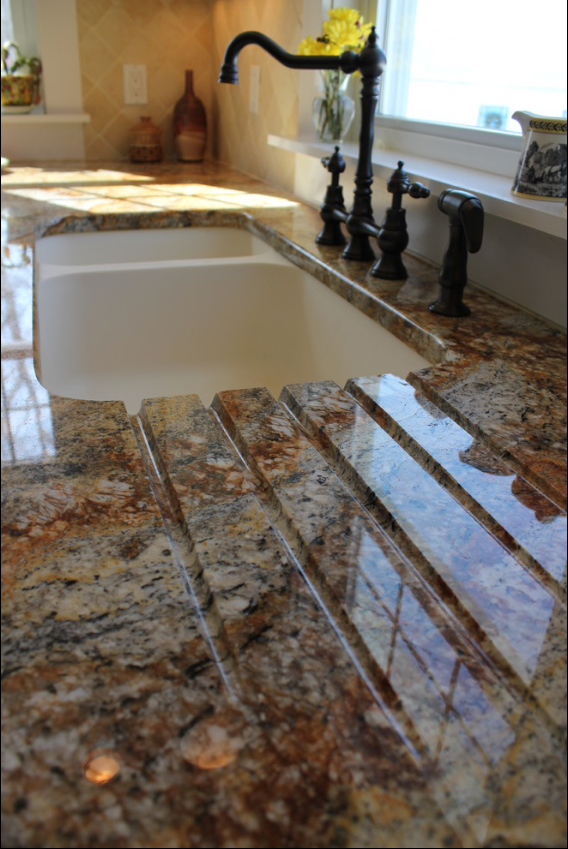 Drain Board Built Into A Granite Countertop Leading To A