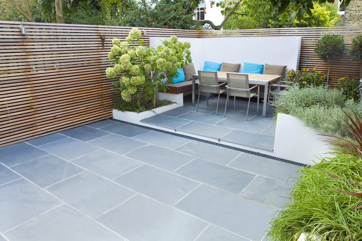 Garden Patio Designs slate patio with cosy corner seating | calgary | pinterest