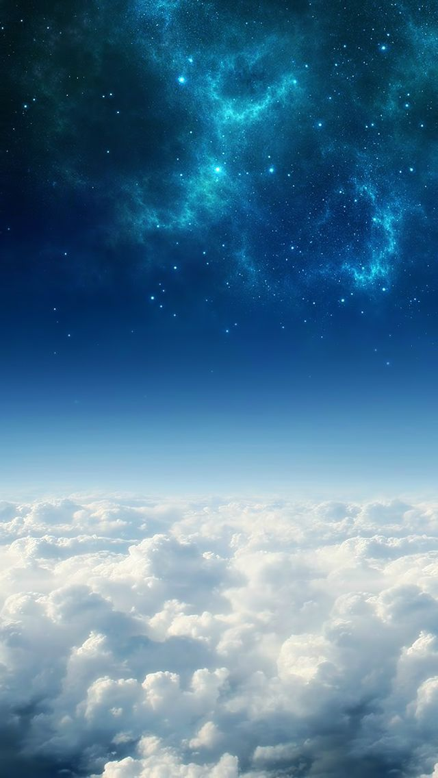 Starry Galaxy Sky over White Fluffy Clouds