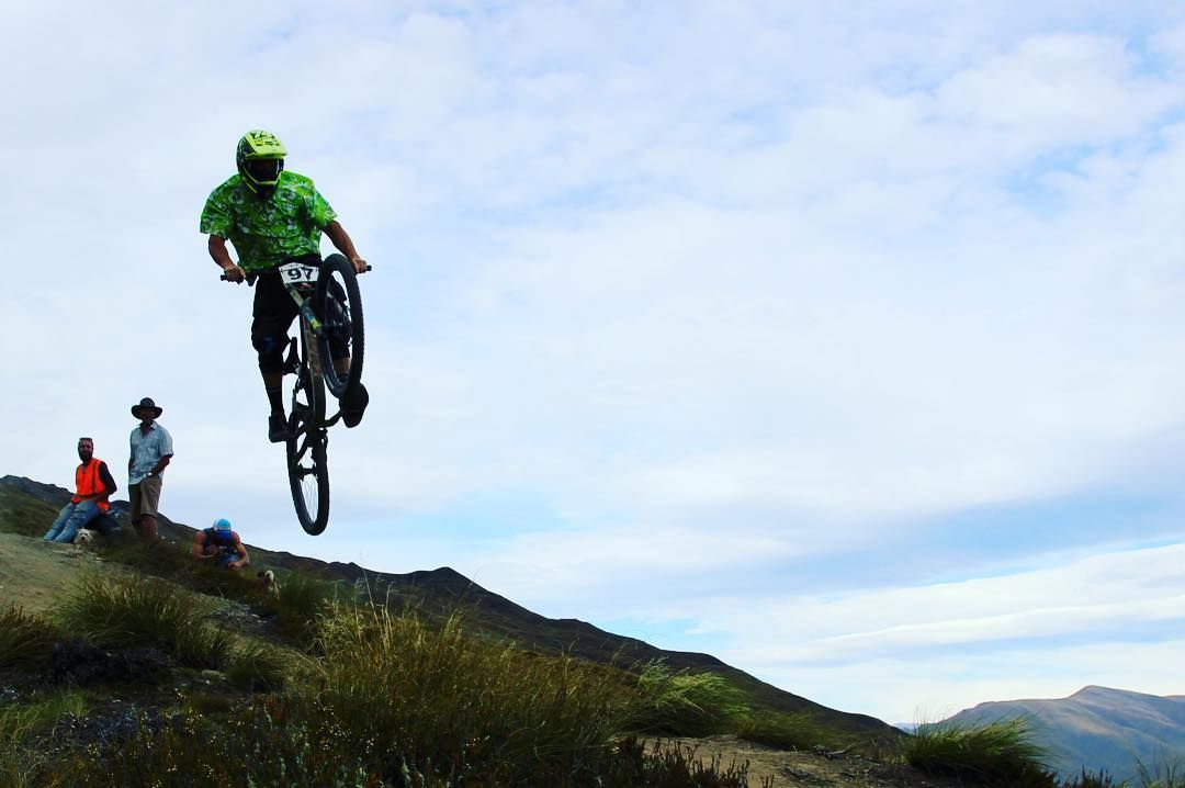 Why ride when you can fly. Nope that's not me. I'm behind the lens. #queenstownlive #mountainbiking #newzealand